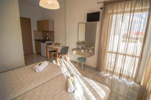 Ein Bett oder Betten in einem Zimmer der Unterkunft Studios George