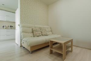 A seating area at Apartment on Semyi Shamshinykh / 2pillows