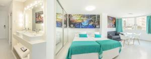 A bed or beds in a room at Benidorm Celebrations Pool Party Resort - Adults Only