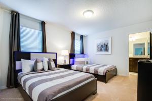 Un ou plusieurs lits dans un hébergement de l'établissement Windsor at Westside Exec Villas- 1828NC