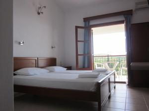 Ένα ή περισσότερα κρεβάτια σε δωμάτιο στο Kolios View Studios