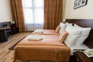 Lova arba lovos apgyvendinimo įstaigoje Spatz Aparthotel