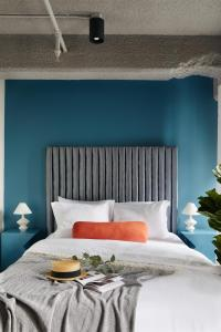 A bed or beds in a room at Maison Sainte-Thérèse By Maisons & co