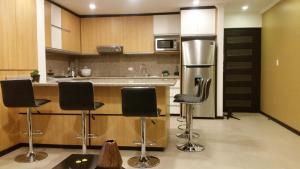 A kitchen or kitchenette at Condominio la Victoria