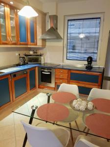 A kitchen or kitchenette at Comfort & luxury at a law price