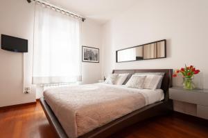 Letto o letti in una camera di Via Bozzi Luxury Home