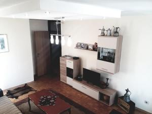 A television and/or entertainment center at Apartment Ambrela