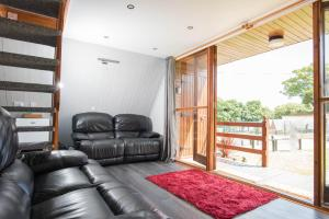 A seating area at Chalet 85, Kingsdown Holiday Park