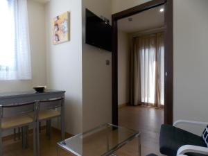 A television and/or entertainment center at Aparthotel Bubal