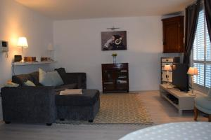 Predel za sedenje v nastanitvi Modern and Homely 2 Bed Flat in Whitechapel