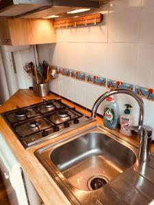 Cuisine ou kitchenette dans l'établissement Happy Flat La Panne