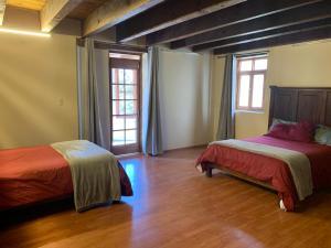A bed or beds in a room at Bungalow al Pie de la Montaña
