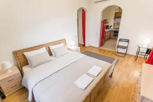 A bed or beds in a room at HB Apartments - Smolenskaya Square