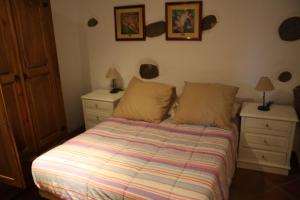 A bed or beds in a room at CASA LOS ABUELOS