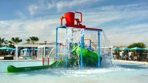 A área de jogos para crianças em EV278852 - Windsor At Westside Resort - 9 Bed 6 Baths Villa