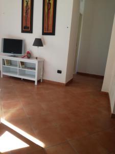 Télévision ou salle de divertissement dans l'établissement Residence I Platani