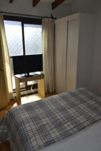 A bed or beds in a room at Apartamento Centro La Serena