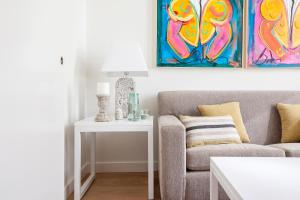 A seating area at Heima Homes Salamanca District - Milla Oro