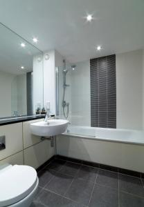 A bathroom at Exclusive Tower Bridge Apartment