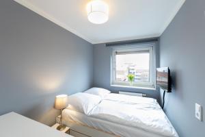 Ein Bett oder Betten in einem Zimmer der Unterkunft Boardinghouse St.Pauli