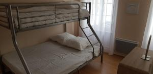 A bunk bed or bunk beds in a room at LISABEL