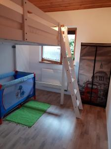 A bunk bed or bunk beds in a room at Ferienhaus Sybille