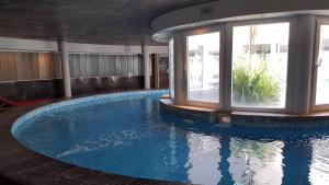 The swimming pool at or near Apart Spa Linda Bay