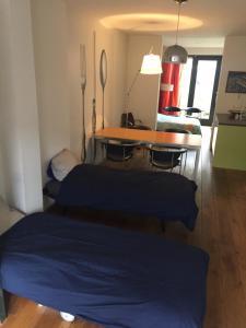 A bed or beds in a room at Studio Zaagmolen