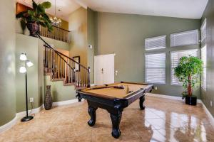 A pool table at COMFORT HOMES LV