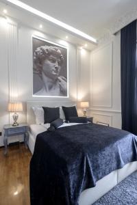 Krevet ili kreveti u jedinici u okviru objekta Ben Akiba Luxury Suites