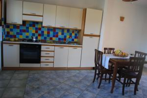 A kitchen or kitchenette at Residence Oasi Blu