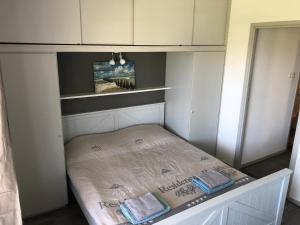Een bed of bedden in een kamer bij Appartement Dishoek
