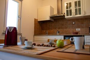 A kitchen or kitchenette at Mama Residence