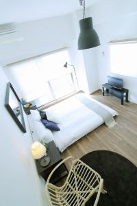 A bed or beds in a room at 30 Sec Hondori Hiroshima Shopping Arcade #702