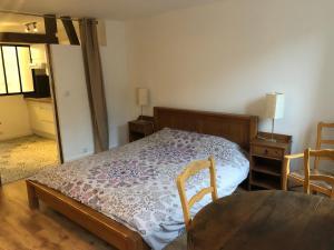Un ou plusieurs lits dans un hébergement de l'établissement Gite ancien relais de saint jacques