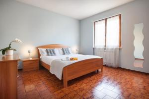A bed or beds in a room at Casa Girasole