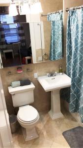 A bathroom at #1Midtown Manhattan Loft Apartment