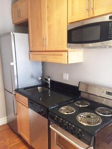 A kitchen or kitchenette at #1Midtown Manhattan Loft Apartment