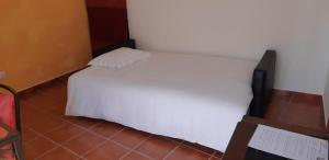 A bed or beds in a room at Casa Azul