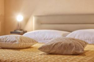 A bed or beds in a room at Casa Vesna