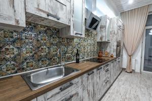 Køkken eller tekøkken på Eco Apartments in french quarter