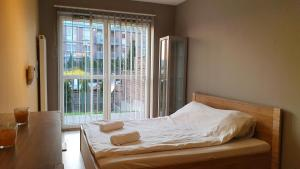 A bed or beds in a room at AnVit apartments