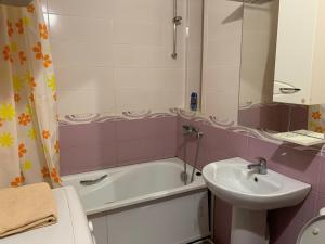 Ванная комната в Apartments On Stabilnaya