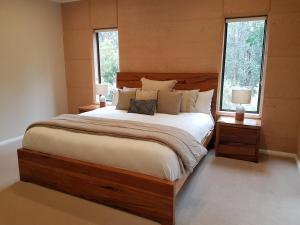 A bed or beds in a room at Jarrah Grove Forest Retreat