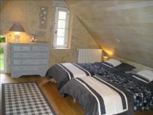En eller flere senger på et rom på Apartment 2 rue de cinq ans: le grand