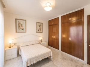A bed or beds in a room at Five-Bedroom Holiday Home in Tarragona