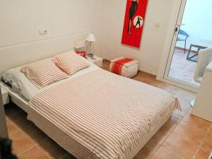 A bed or beds in a room at Apartment Encanto Andaluz