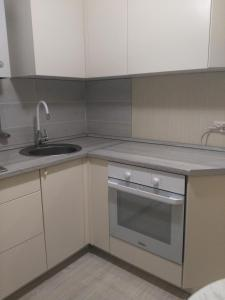 A kitchen or kitchenette at Apartment on Nazarbaeva street