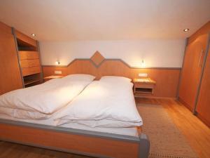 Ein Bett oder Betten in einem Zimmer der Unterkunft Apartment Haus Koch.2