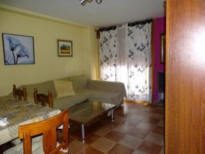 A seating area at Apartamentos Torrecillas